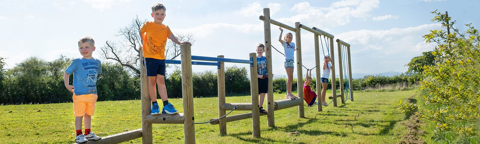 Children on climbing frame at outdoor park in North Wales