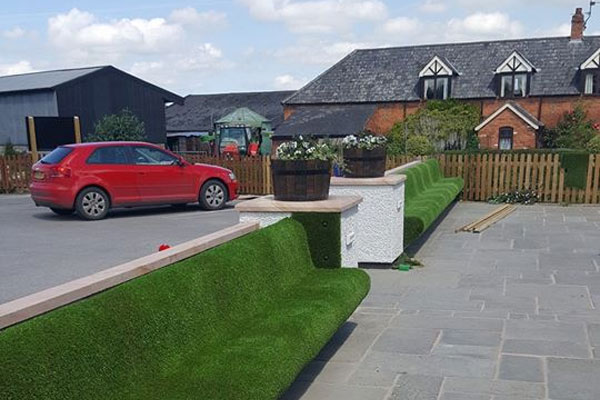 Artificial Grass Seats at Carden Arms in Cheshire